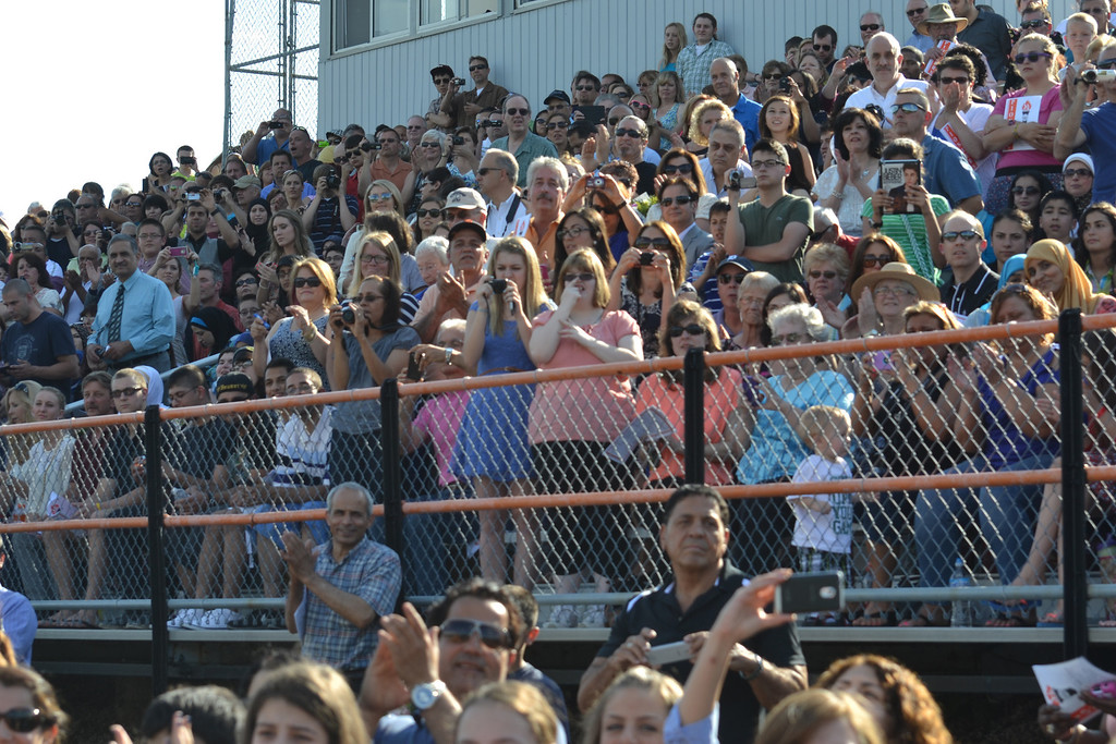 Description of . There were plenty of cameras in the crowd Friday evening at Dearborn High School's graduation ceremony. (Photo by Joe Slezak)