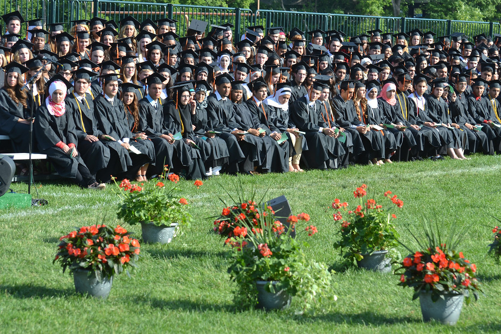 . Dearborn High School seniors wait for the opportunity to receive their diplomas Friday evening. (Photo by Joe Slezak)